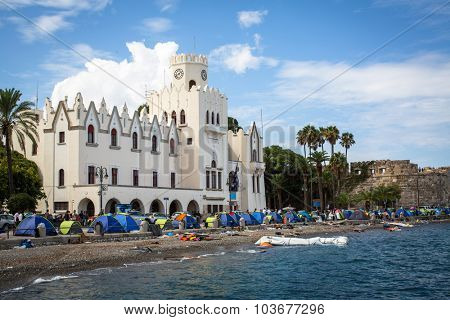 KOS, GREECE - SEP 28, 2015: Tents war refugees in the port of Kos island. Kos island is located just 4 kilometers from the Turkish coast, and many refugees come from Turkey in an inflatable boats.