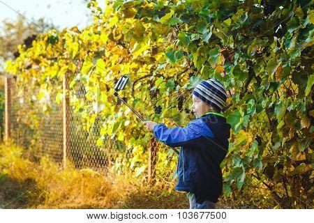 Smart Happy Little Boy Taking Selfie