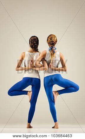 yoga in pair. balance