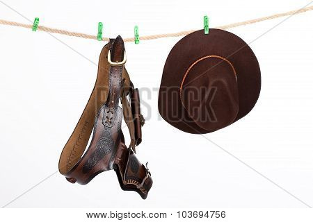 Cowboy Hat And Belt On A Clothesline