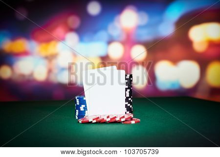 Poker chips with blank cards on table in casino poster