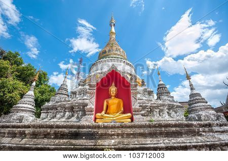White Chedi And Golden Buddha Statue At Wat Buppharam, Chiang Mai