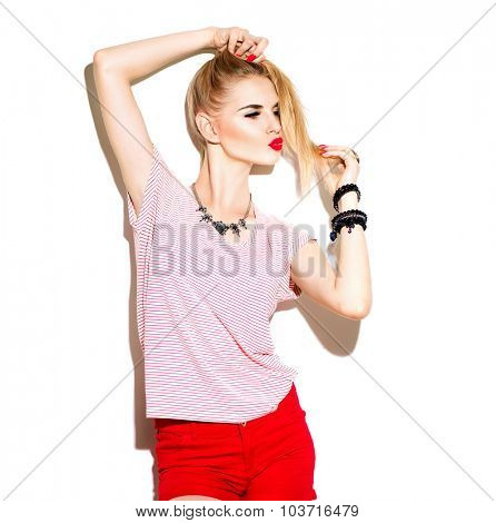 Teenage fashion stylish model girl isolated on white background. Trendy young woman posing in studio