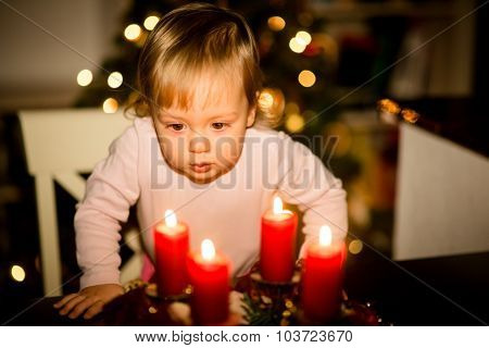 Child looking at advent wreath