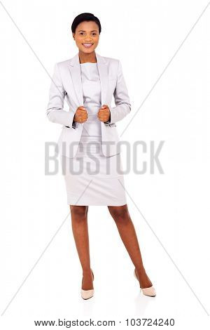 full length portrait of attractive young african business woman posing on white
