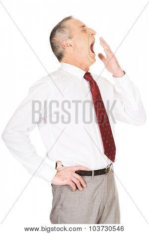 Exhausted sleepy mature businessman yawning. poster