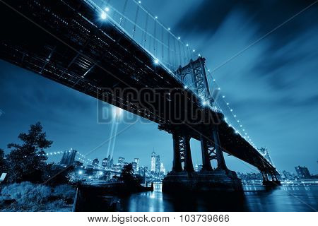 New York City downtown and september 11 tribute at night with Manhattan Bridge