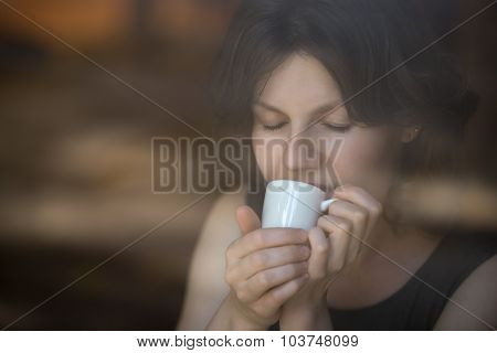 Young Woman Enjoying Coffee