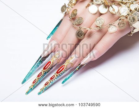 Long beautiful manicure on the fingers of turquoise and red. Nails design. Isolate object. Close-up