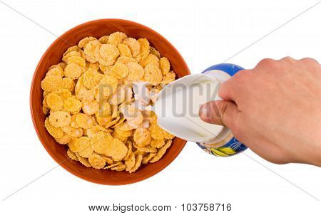 Corn flakes with milk pouring