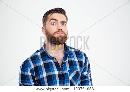 Portrait of a funny man with pencil in beard isolated on a white background