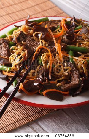 Lo Mein Chinese Noodles With Beef And Muer Macro. Vertical