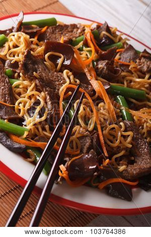 Chinese Lo Mein With Beef, Muer And Vegetables Close-up. Vertical