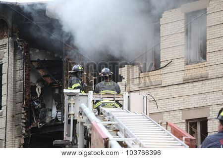 Fire fighters battle smoke