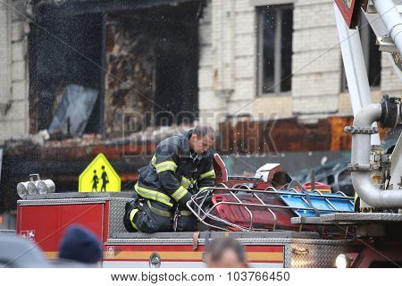 Firefighter on ladder truck