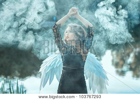 Girl With Angel Wings Is Shrouded In Smoke.
