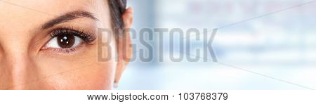 Beautiful young woman eye over blue banner background.