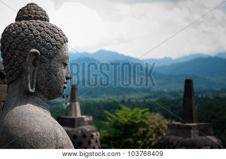 Stone Budhha Sideview In Front Of Two Stupas, Borobudur