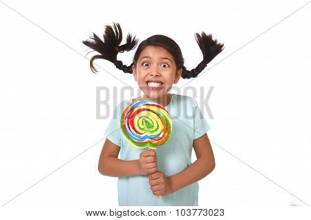 Happy Child Holding Big Lollipop Candy With Pony Tails Flying In Freak Crazy Funny Face