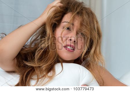 Young Tousled Woman Waking Up Early