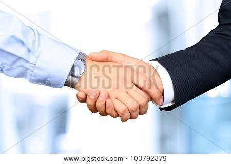 Close-up image of a firm handshake  between two colleagues poster