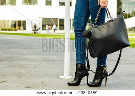 Woman Legs In Heels Shoes Handbag In Hand