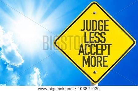 Judge Less Accept More sign with sky background