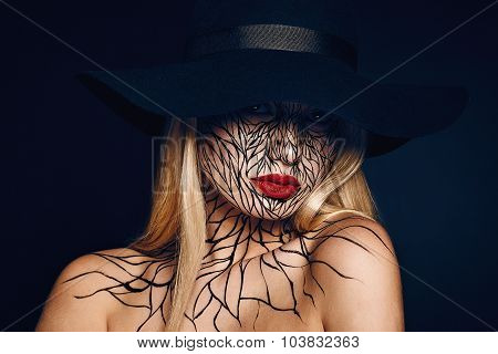 fashion portrait of girl with faceart