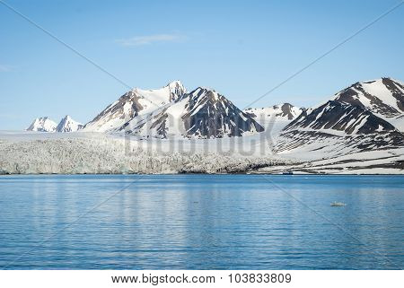 Sailing Boat In Front Of The Glacier In Svalbard, Arctic