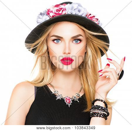 Beautiful sexy blonde woman with red lips and manicure in modern black hat. Beauty fashion model girl portrait with accessories- bracelets, necklace and elegant hat, isolated on a white background