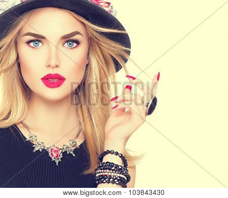 Beautiful sexy blonde woman with red lips and manicure in modern black hat. Beauty fashion model girl portrait with accessories- bracelets, necklace and elegant hat