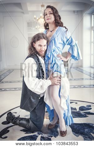 Handsome Man In Medieval Costume Seduces Beautiful Woman