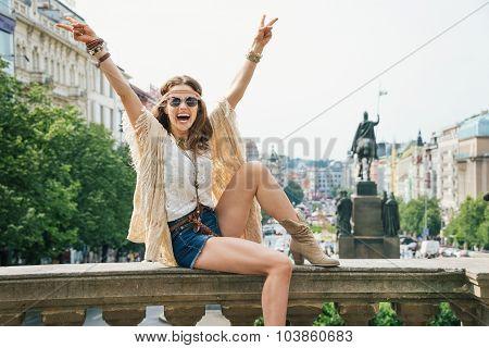 Hippie Woman Showing Victory Gesture On Wenceslas Square, Prague