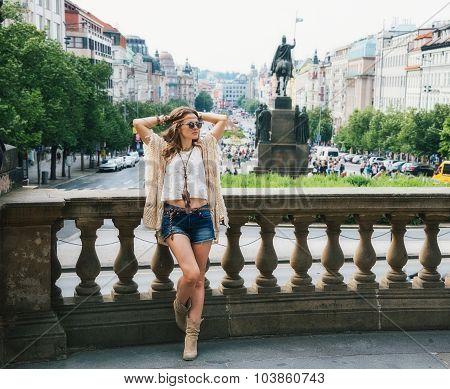 Hippy-looking Woman Relaxing Near Stone Parapet In Prague