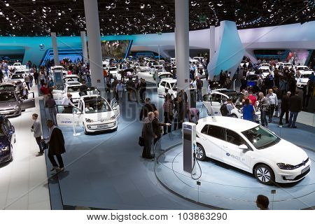 FRANKFURT GERMANY - SEP 13: Visitors at the IAA motor show on Sep 13 2013 in Frankfurt. More than 1.000 exhibitors from 35 countries are present at the world's largest motor show. poster