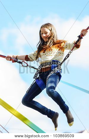 Teenage Girl Jumping With Bungie