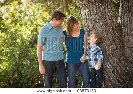 Happy young family standing outside