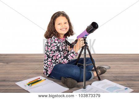 Little girl holding her telescope