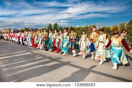 NOVI SAD, SERBIA-OCT 4, 2015: Guinness World Record Largest Folk Dance on Oct 4. 2015 in Novi Sad, Serbia. Over 12.000 participants break the Guinness World Record by simultaneously dancing a Kolo