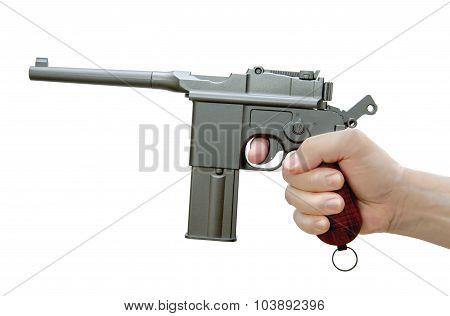 The Handgun Mauser M-72 In His Hand. Air Gun