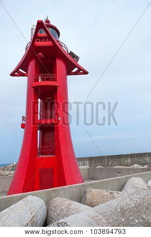 Red Lighthouse In Harbor With Sky On Background
