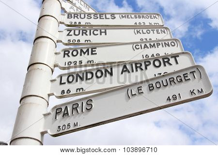 Airport destinations in Europe - old sign at Birmingham Airport UK. Directions to Brussels Zurich Rome London and Paris. poster
