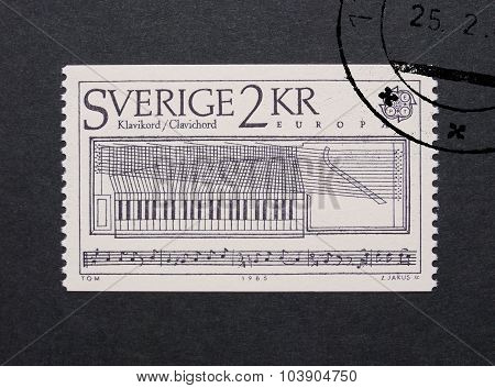 STOCKHOLM SWEDEN - MAY 23 2015: A stamp printed by Sweden shows a clavichord stringed keyboard music instrument