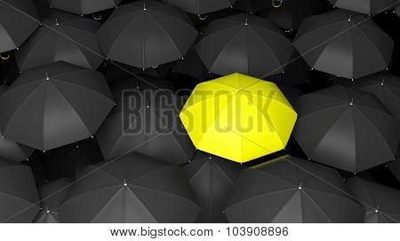 Classic large black umbrellas tops with one yellow standing out.