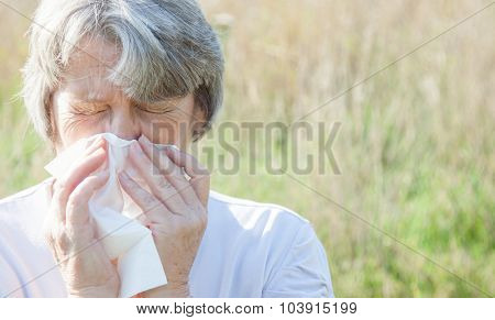 Old age woman using tissue