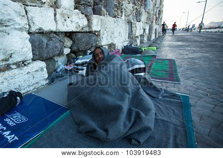 KOS, GREECE - SEP 28, 2015: Unidentified refugee. More than half are migrants from Syria, but there are refugees from other countries -Afghanistan, Pakistan, Iraq, Iran, Mali, Eritrea.