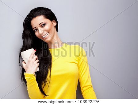 Smiling Young Woman With Cup Of Tea.