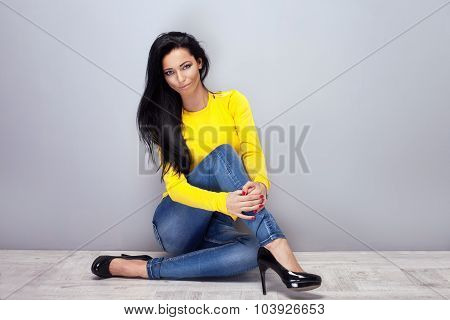 Attractive Young Girl In Jeans. Studio Shot.