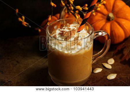 Pumpkin spice latte on moody background
