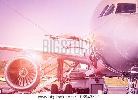 Detail Of Airplane At Terminal Gate Before Takeoff - Travel Concept And Wander Around The World